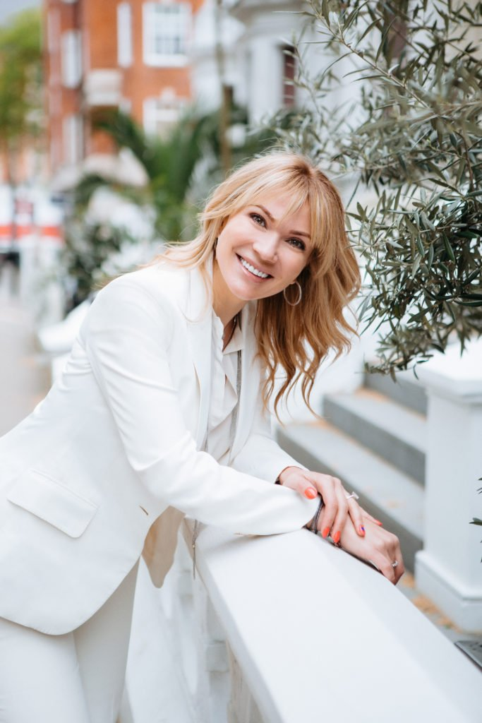 dr-galyna-aesthetics-doctor-wearing-white-suit-outside